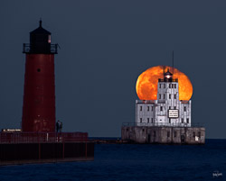 full moon rise over Milwaukee Breakwater Lighthouse and the Milwaukee Harbor Lighthouse