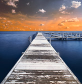 long pier at sunset on lake